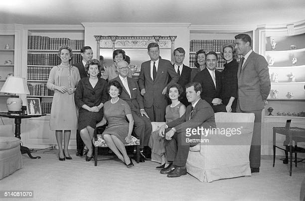 President-elect John F. Kennedy stands at the center of his large family in the living room of his father's home in Hyannisport. Standing by him are:...