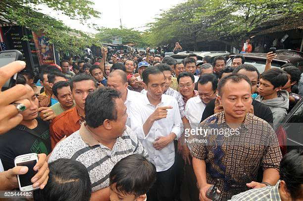 Presidentelect Joko Widodo greeted supporters during a visit at a second hand market in Surakarta Central Java Indonesia on July 26 Presidentelect...