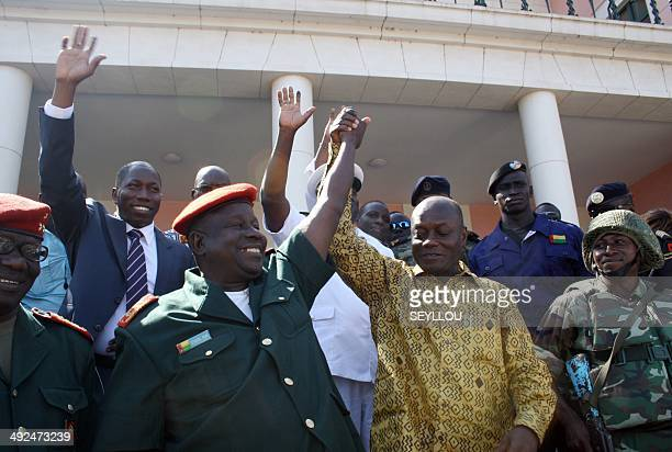 Presidentelect Jose Mario Vaz and GuineaBissau Army Chief of Staff General Antonio Indjai react following a meeting with the outcoming president at...