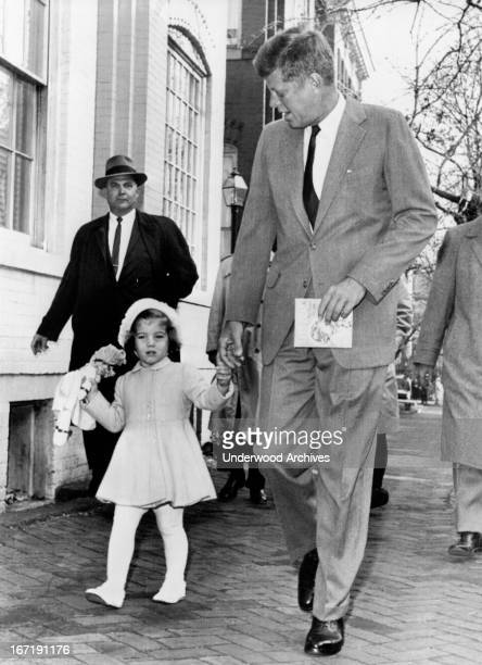 Presidentelect Kennedy walks with his daughter Caroline on their way to church services on her third birthday Washington DC November 27 1960...