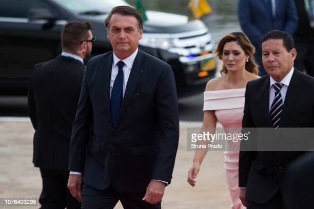 Presidentelect of Brazil Jair Bolsonaro his wife Michelle Bolsonaro Vice PresidentElect of Brazil Hamilton Mourao walk towards the National Congress...