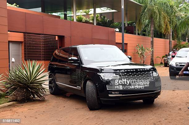 Presidentelect Patrice Talon is being driven out of his home to avoid supporters on March 21 2016 in Cotonou Businessman Patrice Talon won the second...
