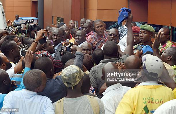 Presidentelect Patrice Talon speaks to supporters at his home in Cotonou on March 21 2016 Businessman Patrice Talon won the second round of Benin's...