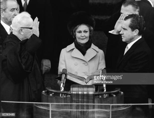 Presidentelect Richard Nixon takes the oath of office as he is sworn in as the 37th President of the US by Supreme Court Chief Justice Earl Warren...