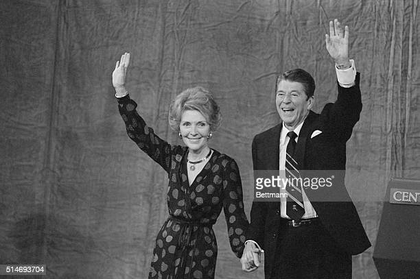 Presidentelect Ronald Reagan and his wife Nancy wave to supporters in Los Angeles after President Jimmy Carter conceded that Reagan had won the...