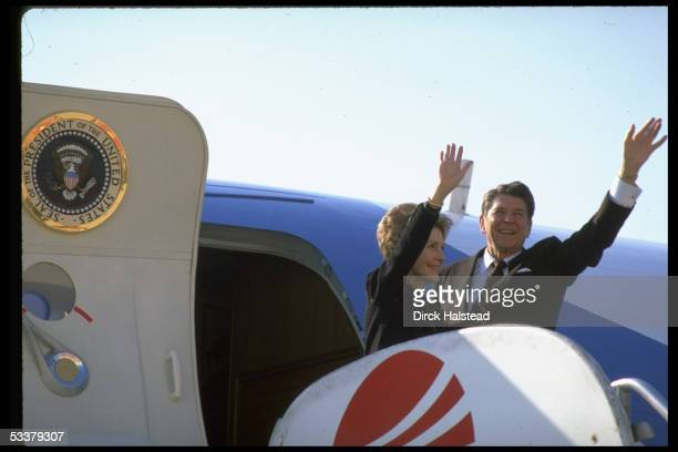 Presidentelect Ronald Reagan and wife Nancy wave