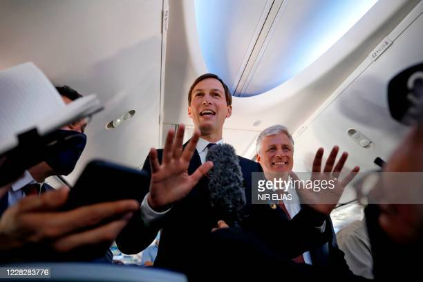 Presidential Adviser Jared Kushner and US National Security Adviser Robert OBrien talk to the media in a El Al airplane, which is carrying a...