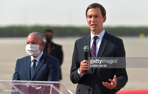 Presidential Adviser Jared Kushner speaks next to Head of Israel's National Security Council Meir Ben-Shabbat at the tarmac of Abu Dhabi airport...