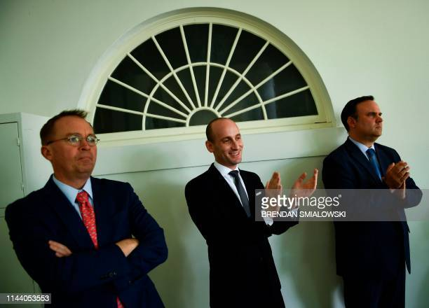Presidential advisor Stephen Miller White House acting Chief of Staff Mick Mulvaney and White House Social Media Director Dan Scavino listen as US...