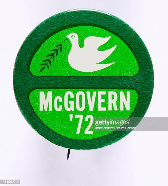 S presidential campaign button pin for George McGovern The pin incorporates the 70s ecology symbol around the outside edge and the peace sign in the...