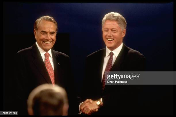 GOP presidential cand Bob Dole his rival Democratic incumbent Pres Bill Clinton shaking hands all smiles during 1st election campaign debate