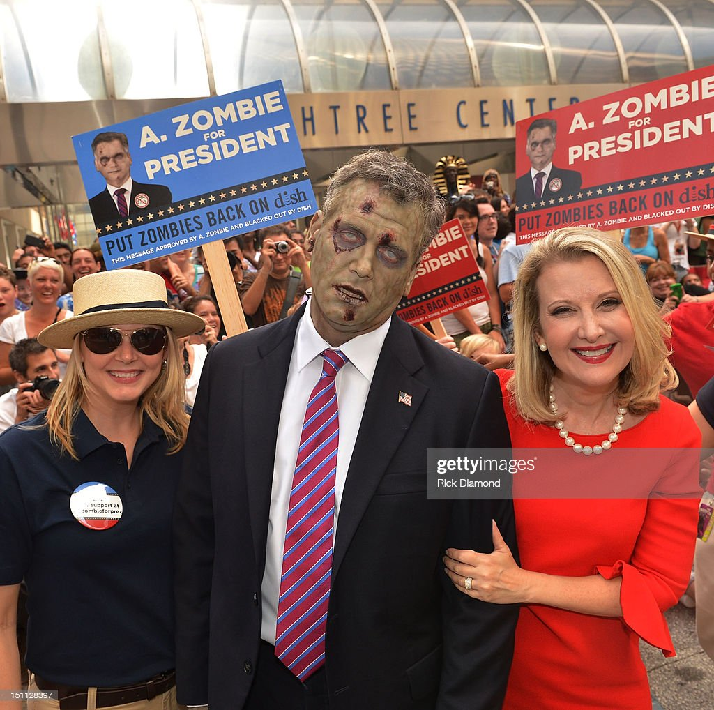 Presidential Candidate A. Zombie and his human wife Patty Morgan-Zombie attend The Dragon*Con Parade 2012 on Sweet Auburn Avenue on September 1, 2012 in Atlanta, Georgia.