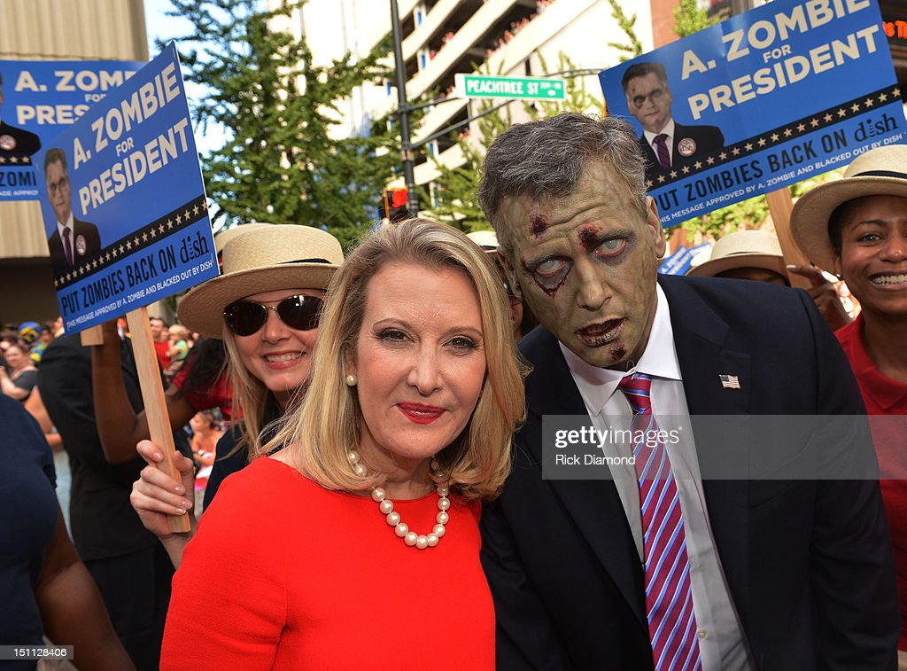 Presidential Candidate A. Zombie (right) and his human wife Patty Morgan-Zombie attend The Dragon*Con Parade 2012 on Sweet Auburn Avenue on September 1, 2012 in Atlanta, Georgia.