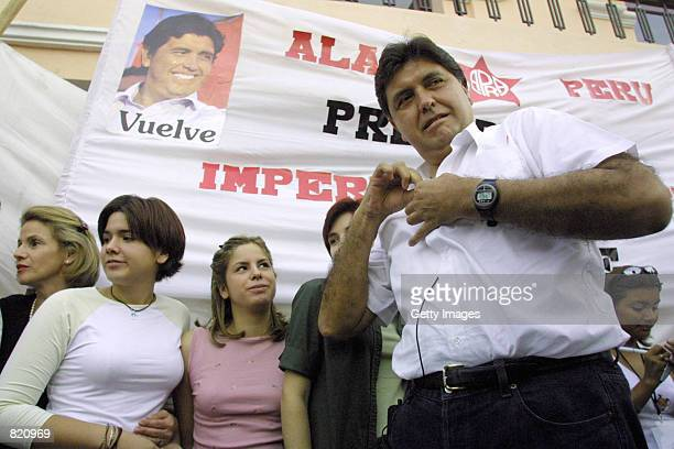 Presidential candidate Alan Garcia puts on his microphone as he prepares to to give a speach during his political rally April 22001 in the south city...