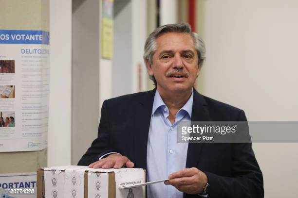 Presidential candidate Alberto Fernandez of 'Frente de Todos' casts his vote during the presidential elections in Argentina at Universidad Católica...