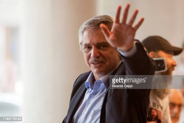 Presidential candidate Alberto Fernandez of 'Frente de Todos' greets supporters at a Starbucks coffee shop in Puerto Madero after voting during the...