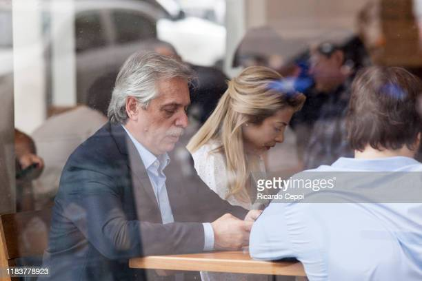 Presidential candidate Alberto Fernandez of 'Frente de Todos' has breakfast with his partner Fabiola Yañez and friends at a Starbucks coffee shop in...