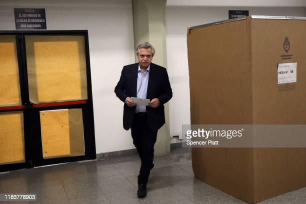 Presidential candidate Alberto Fernandez of 'Frente de Todos' walks out of the voting booth as he casts his vote during the presidential elections in...