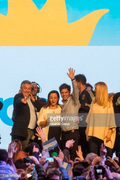 Presidential candidate Alberto Fernandez waves to supporters at the Frente de Todos party headquarters during the Simultaneous and Mandatory Open...