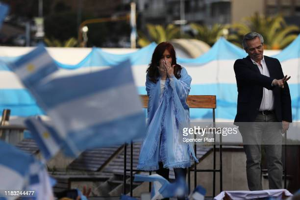 Presidential candidate Alberto Fernández and his running mate Cristina Fernández de Kirchner of 'Frente de Todos' walk on to stage during their...