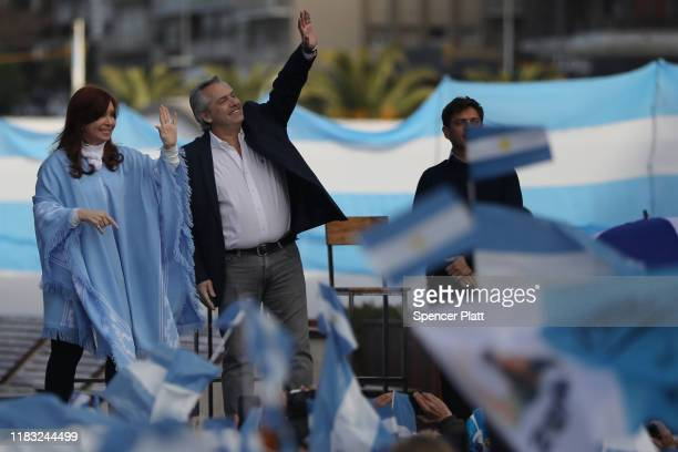 Presidential candidate Alberto Fernández and his running mate Cristina Fernández de Kirchner of 'Frente de Todos' walk on stage along with Candidate...