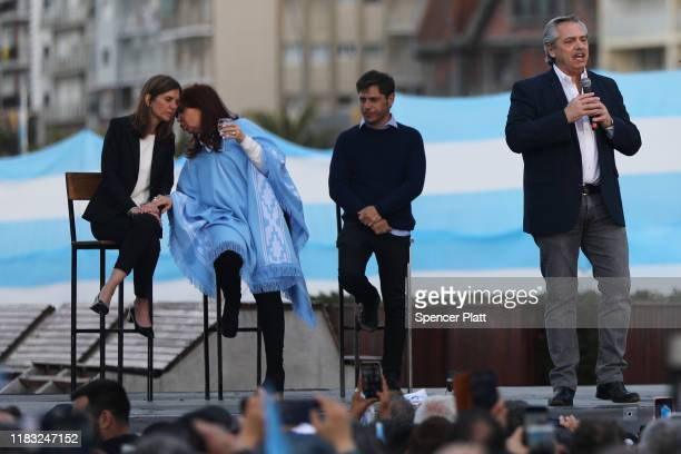 Presidential candidate Alberto Fernández speaks as his running mate Cristina Fernández de Kirchner watches during their closing rally on October 24...