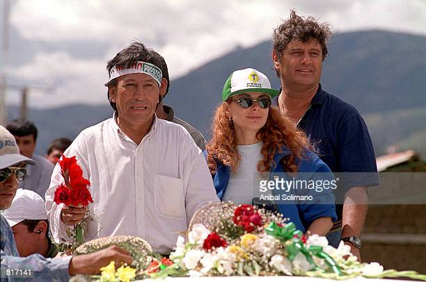 Presidential candidate Alejandro Toledo accompanied by his wife Eliane center and vice presidential candidate Raul Diez Canseco greets supporters...