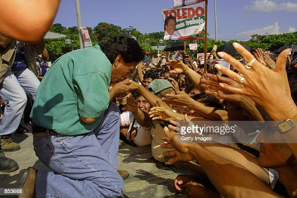 Presidential candidate Alejandro Toledo kisses the hands of a political supporter during a political rally March 29 2001 in the town of Contamana...