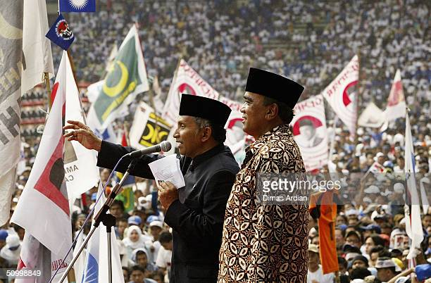 Presidential candidate Amien Rais accompanied by his Vice Presidential candidate Siswono Yudohusodo delivers a speech to his supporters at a large...