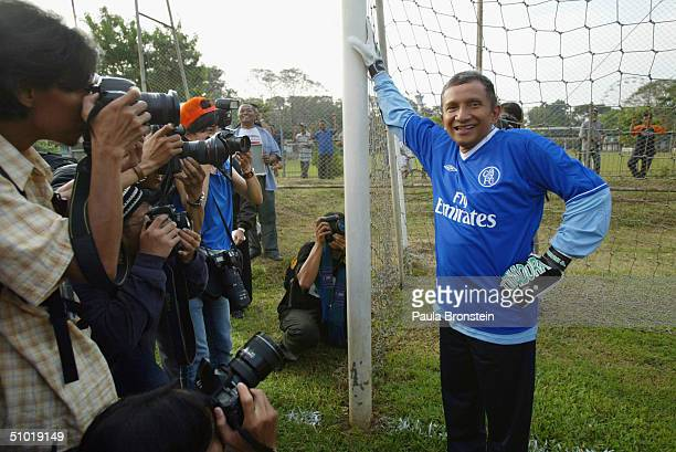 Presidential candidate Amien Rais poses before showing off his sporting talents as the media cover a friendly soccer match between Amien's party the...