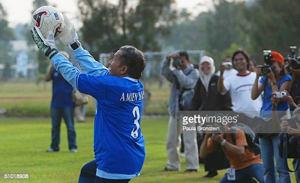 Presidential candidate Amien Rais shows off his goal keeping talents as the media cover a friendly soccer match between Amien's party the National...