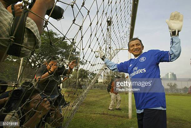 Presidential candidate Amien Rais shows off his sports talents as a goalie while the media cover a friendly soccer match between Amien's party the...