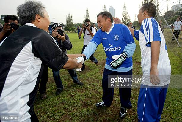 Presidential candidate Amien Rais shows off his sports talents as the media covers a friendly soccer match between Amien's party the National Mandate...