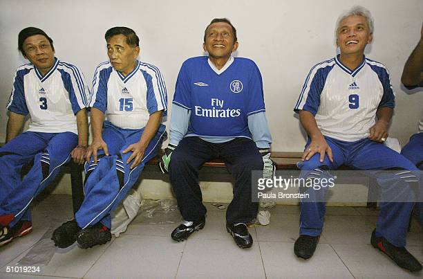 Presidential candidate Amien Rais sits in the locker room with his team mates before a friendly soccer match between Amien's party the National...