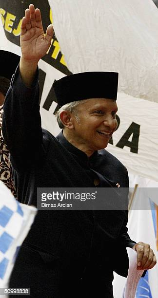 Presidential candidate Amien Rais waves to his supporters at a large rally on June 26 2004 in the capital Jakarta Indonesia Indonesia is scheduled to...
