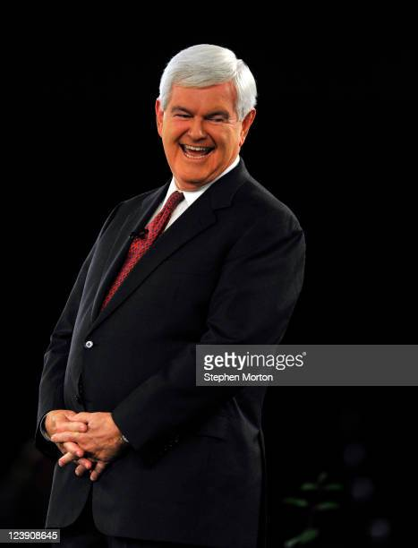 Presidential candidate and former Georgia Congressman Newt Gingrich laughs at a remark during the American Principles Project Palmetto Freedom Forum...