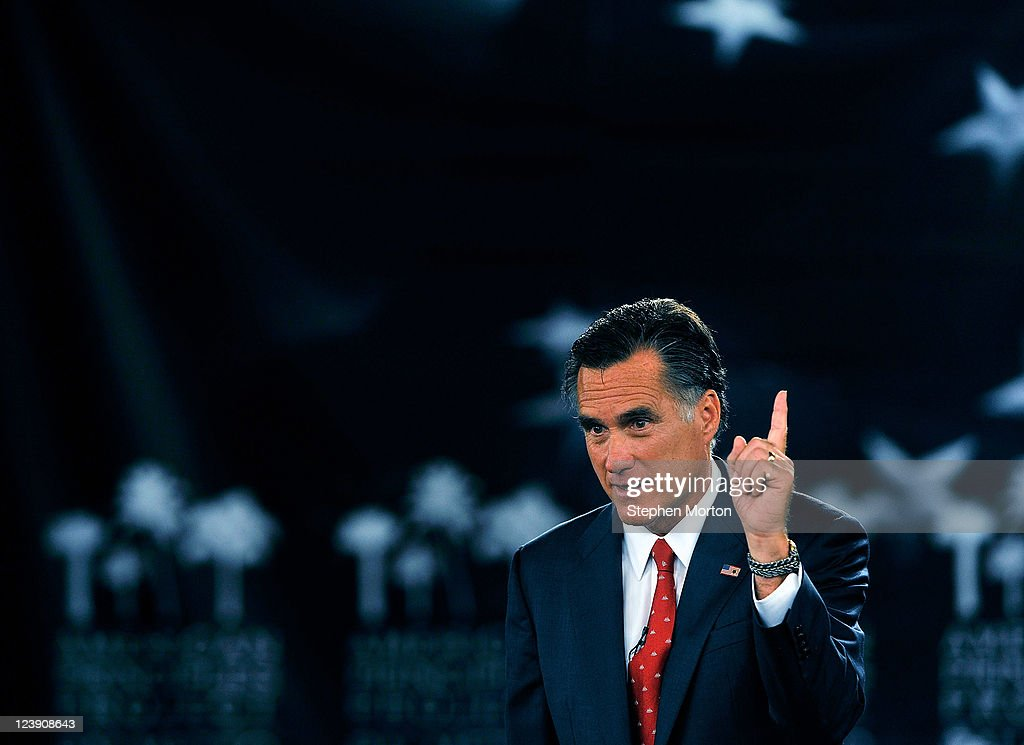 GOP Presidential candidate and former Massachusetts Governor Mitt Romney gestures as he answers a question during the American Principles Project Palmetto Freedom Forum, September 5, 2011 in Columbia, South Carolina. Herman Cain, Ron Paul, Michelle Bachmann and Newt Gingrich are also scheduled to attend the forum hosted by Sen. Jim DeMint (R-SC). Texas Governor Rick Perry was scheduled to attend as well, but he decided to return to Texas because of the wildfires burning across the state.