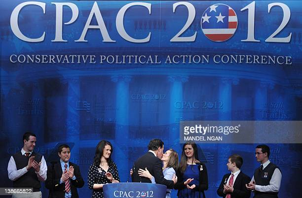 Presidential candidate and former Pennsylvania senator Rick Santorum kisses his wife after addressing the 39th Conservative Political Action...