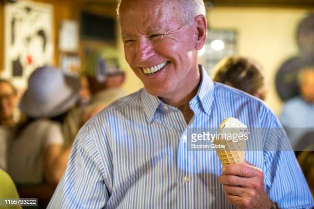 Presidential candidate and former Vice President Joe Biden laughs after getting served ice cream at Annabelle's Natural Ice Cream in Portsmouth, NH...