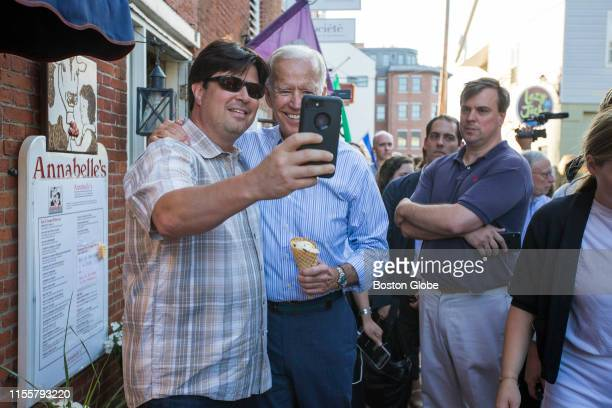 Presidential candidate and former Vice President Joe Biden takes a photo with a supporter outside of Annabelle's Natural Ice Cream in Portsmouth, NH...