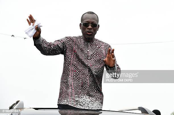 Presidential candidate and leader of coalition of the opposition Patrice Talon waves to supporters during a campaign rally in the Ekpe district near...