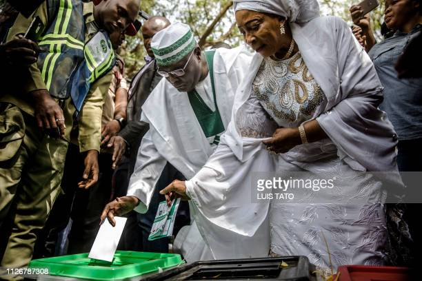 PDP Presidential candidate and main opposition leader Atiku Abubakar casts his vote along with his wife Amina Titilayo AtikuAbubakar at Agiya polling...