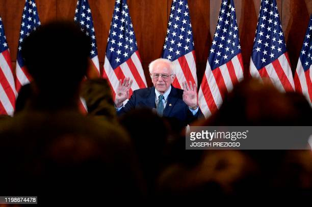 US Presidential Candidate and US Senator Bernie Sanders receives a standing ovation as he enters the room before giving his response to US President...