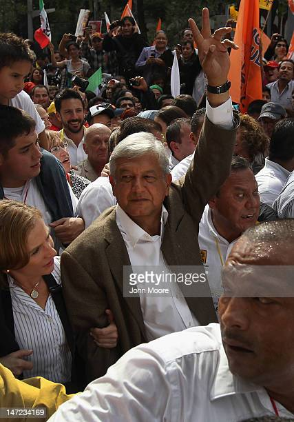 Presidential candidate Andres Manual Lopez Obrador of the leftist Party of Democratic Revolution marches with supporters to his final campaign rally...