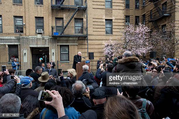 Presidential candidate Bernie Sanders holds a campaign rally outside of the apartment building where he grew up in the Midwood neighborhood of...