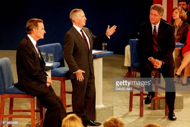 Presidential candidate Bill Clinton, and U.S. President George Bush listen as Independent presidential candidate Ross Perot answers a question 15...