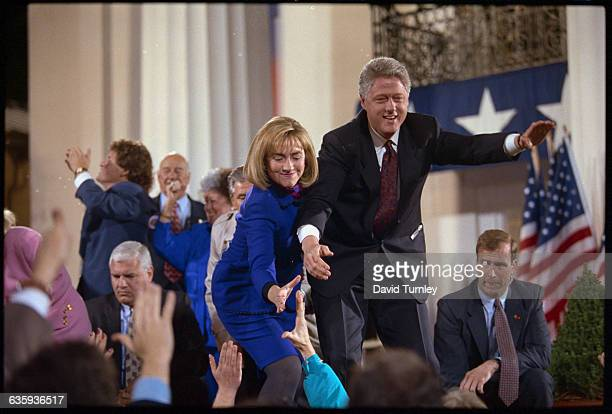 Presidential candidate Bill Clinton and wife Hillary shake hands and wave to supporters at a political rally in Little Rock
