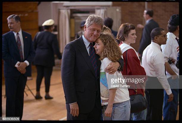 Presidential candidate Bill Clinton hugs his daughter Chelsea at a polling place in Little Rock Arkansas on Election Day 1992