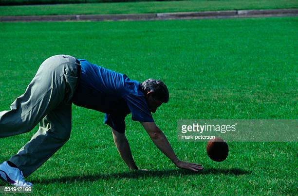 Presidential candidate Bill Clinton participates in a game of touch football while campaigning in Carlisle Pennsylvania circa July 1992