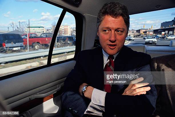 Presidential candidate Bill Clinton rides in a car on his way to a campaign stop in Rhode Island Clinton would win the 1992 presidential election...